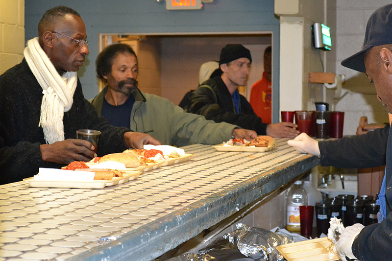 Guests receive meals at Goodwill Rescue Mission